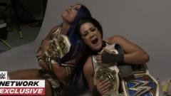 Sasha Banks & Bayley Take Pictures On The Floor Crying With WWE Women's Tag Team Titles