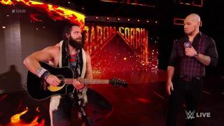 Elias Interrupted Again; Gets Cheered Following Guitar Shot To Baron Corbin