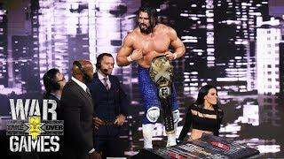 Andrade 'Cien' Almas celebrates his title victory over Drew McIntyre at NXT TakeOver: WarGames.