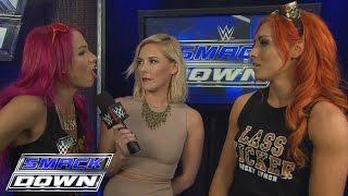 Fight Size Update: Sasha Banks Teases A Move To SmackDown Live, Paul Heyman Reacts To Roman Reigns' Entrance, Titus O'Neil, More