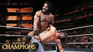 Jinder Mahal works over AJ Styles' ribs in the Clash of Champions main event.