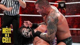 Jeff Hardy and Randy Orton in the midst of their Hell in a Cell encounter.